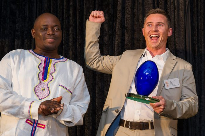 GREEN ECONOMY CHAMPION NCPC SA Director Ndivhuho Raphulu Presents The Eco Logic Green Economy Award To Tiaan De Jager Of GreenFin Financial Services