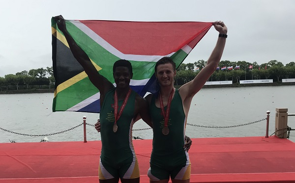 Mzwandile Sotsaka (left) and Brad Betts, of Rhodes, celebrate their bronze medal in the heavyweight doubles rowing event at the FISU World University Championships in Shanghai, China, this month. Photo: Supplied