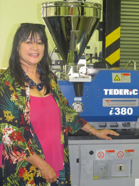 Isabelle Bretteny Plastics|SA's Regional Training Manager (Western Cape) proudly showing off the the new Tederic 1380 Injection Moulding Machine